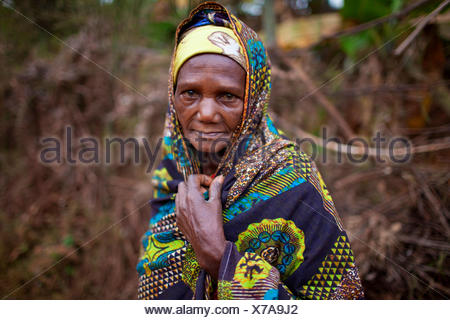 portrait of an elderly woman in traditional african clothing, Burundi, Karuzi, Buhiga - Stock Photo