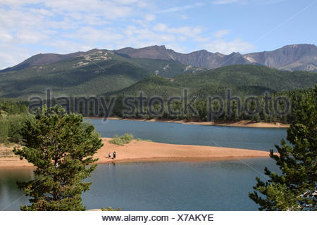 Scenic View Of Lake And Mountains Against Sky - Stock Photo
