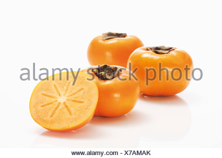 Kaki fruits, and sliced Kaki fruit - Stock Photo