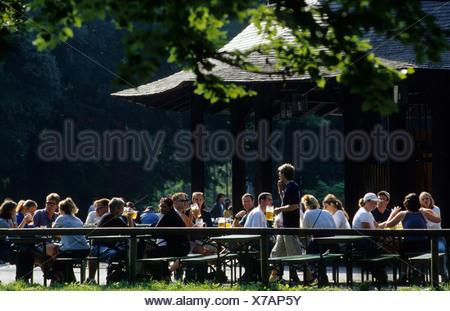 Beer garden at the Chinese Tower, chinesischer Turm, English Garden, Munich, Bavaria, Germany, Europe - Stock Photo