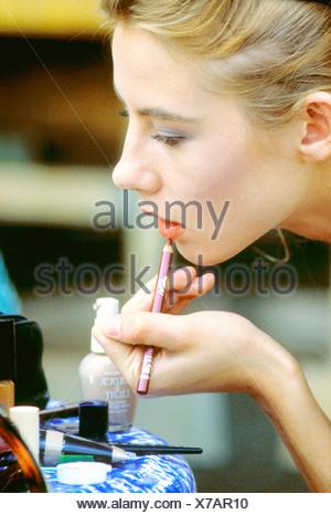 Female applying lipliner - Stock Photo