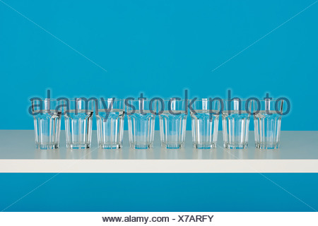 Eight glasses of water - Stock Photo