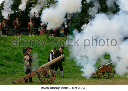 Gun salutes being fired from cannons at a folk festival in Muehldorf am Inn, Upper Bavaria, Bavaria, Germany, Europe - Stock Photo