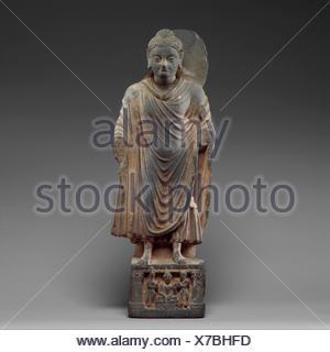 Standing Buddha. Date: ca. 3rd-4th century; Culture: Pakistan (ancient region of Gandhara); Medium: Schist; Dimensions: H. 20 in. (50.8 cm); W. 7 1/4 - Stock Photo