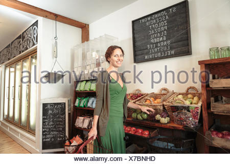 Female customer shopping in country store - Stock Photo