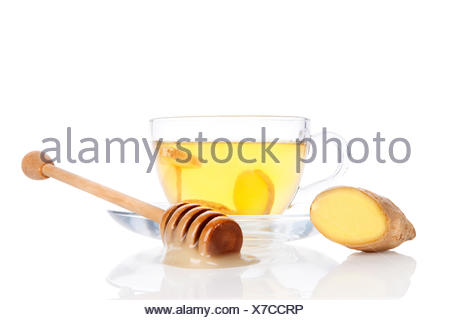 Cup of ginger tea with honey isolated. - Stock Photo