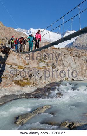 Traveller, Gauligletschersee, Urbachtal, mountain, mountains, canton, Bern, Gauli, Gauligebiet, Gauligletscher, bridge, suspensi - Stock Photo