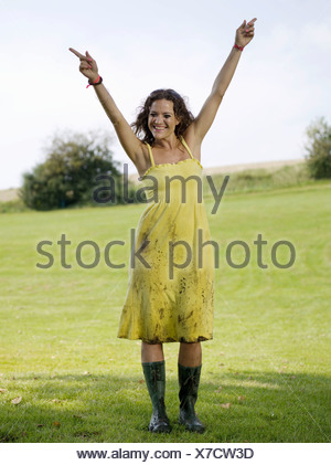Woman dancing in rubber boots - Stock Photo