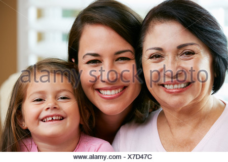 Female Members Of Multi Generation Family Relaxing At Home Together - Stock Photo
