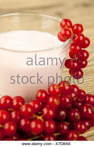 fresh currant yogurt shake for dessert in a glass - Stock Photo