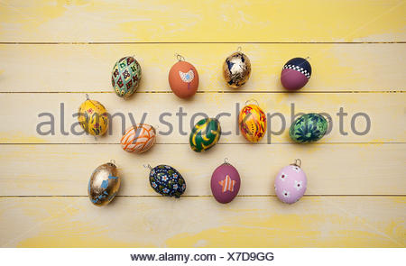 hand painted easter eggs on wooden table - Stock Photo