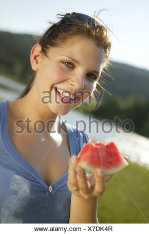 Teenager watermelon eating cheerfully portrait series woman young teenagers girl 15-20 years 20-30 years long-haired brunette - Stock Photo