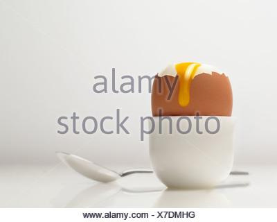 Runny Boiled Egg - Stock Photo