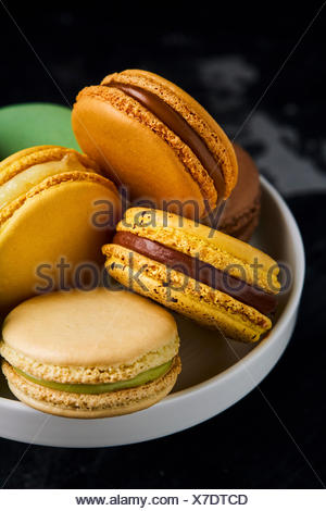 bowl with macarons of various tastes and colours - Stock Photo