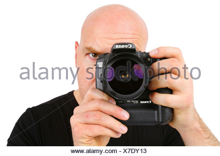man looks through and in a camera - Stock Photo