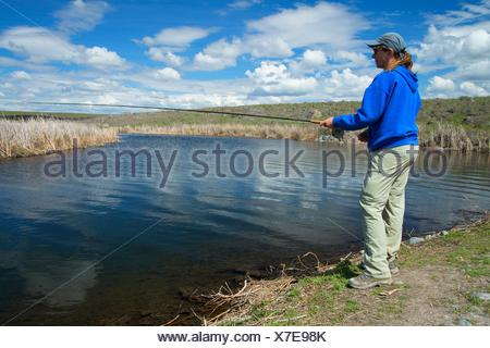 Fishing on Rocky Ford Creek, Rocky Ford Creek Water Access Site, Washington. - Stock Photo