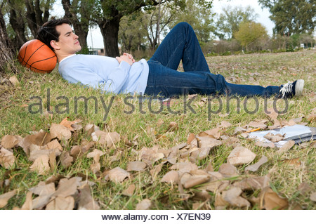 Man, Sports, campus, university, basket's, basketball's, ball, rest, play, playing, practice, practicing, park, trees, nature. - Stock Photo