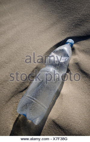 Conception,plastic flask,beach, - Stock Photo