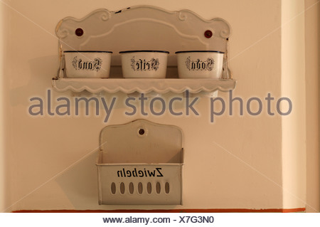 Turn-of-the-century kitchen shelves and bowls for baking soda, soap, sand and onions in a house in Lauf an der Pegnitz, Middle  - Stock Photo