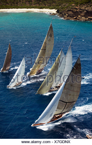 From left; 'Ranger', 'Windrose' and 'Velsheda' chase a couple of smaller boats at Antigua Classic Yacht Regatta, Caribbean 2004. - Stock Photo