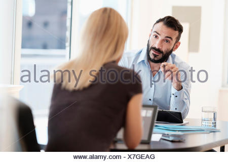 Man and woman talking in office - Stock Photo