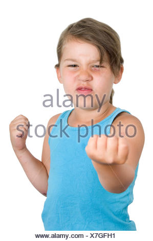 Mad girl with raised fist - Stock Photo