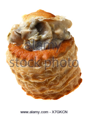 A vol-au-vent puff pastry case filled with chicken and mushroom in a white sauce. - Stock Photo