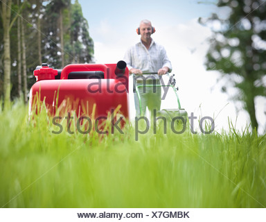 Can of gasoline on grassy lawn - Stock Photo