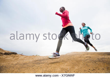Two women jogging along the coast fitness - Stock Photo