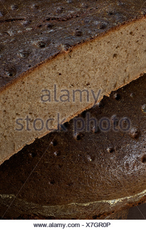 Mixed wheat and rye bread, made with sourdough, rye flour, wheat flour and spelt flour baked in a household oven - Stock Photo