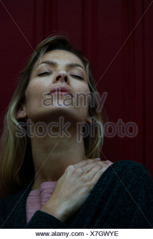 Woman rubbing sore shoulder - Stock Photo