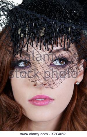 Close-up of elegant woman wearing veil - Stock Photo