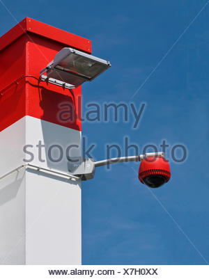 360-degree camera on wall against blue sky, monitoring, security, PublicGround - Stock Photo
