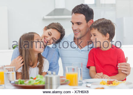 Cute family during the dinner - Stock Photo