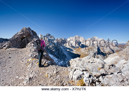 Hiker on Bepi Zac climbing route in the San Pellegrino Valley above the San Pellegrino Pass, currently on Costabela Mountain - Stock Photo