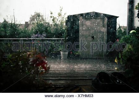 small garden houses in the rain - Stock Photo