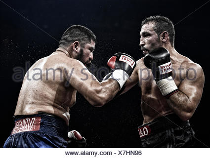 Boxing match, Firat Arslan, GBR, black trousers against Alejandro Emilio Valori, ARG, blue trousers, Hanns-Martin-Schleyer Halle - Stock Photo