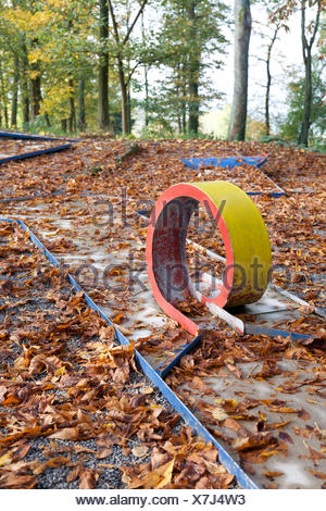 Sinsheim, Germany, Autumn leaves on minigolf - Stock Photo