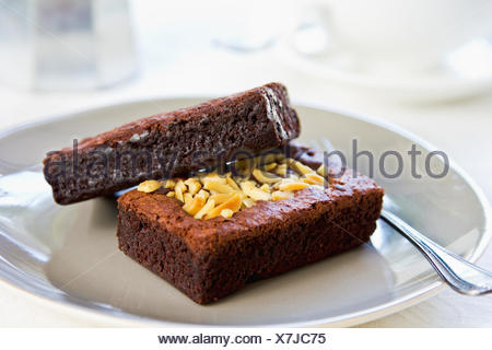 Varieties of  Chocolate Brownies by a cup of coffee - Stock Photo