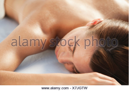 Young woman lying on massage table, close-up - Stock Photo