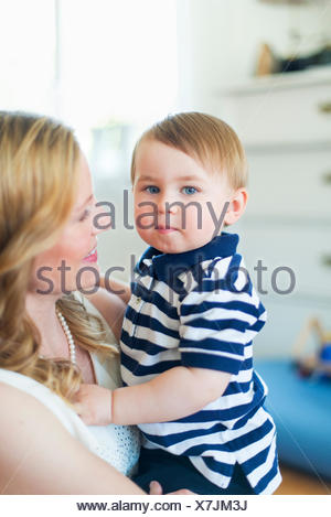 Sweden, Portrait of boy (18-23 months) with mother - Stock Photo