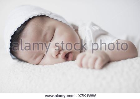 Close up of baby girl sleeping - Stock Photo