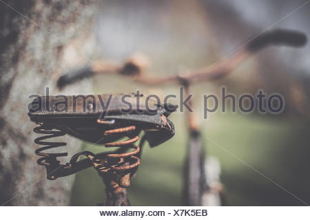 Rusty bicycle saddle - Stock Photo