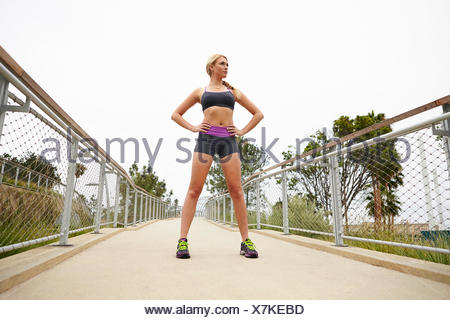 Woman standing on bridge - Stock Photo