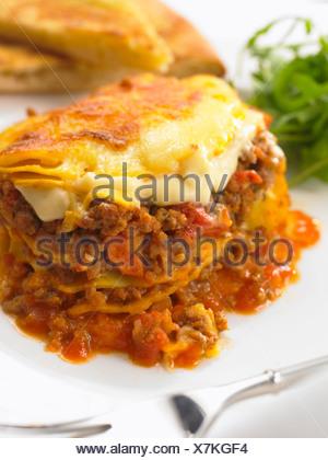 Beef Lasagne and Garlic Bread - Stock Photo