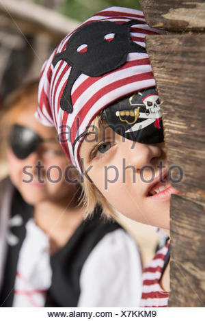 Boy dressed up as pirate playing in a playground, Bavaria, Germany - Stock Photo