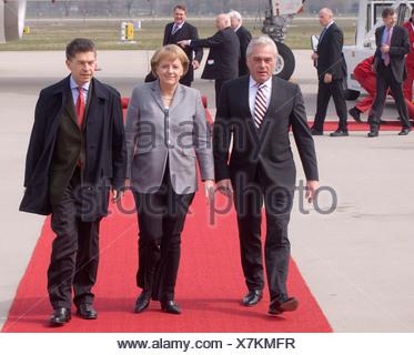 Heribert Rech, interior minister of Baden-Wuerttemberg, Federal Chancellor Dr. Angela Merkel and Prof. Joachim Sauer, 60 years  - Stock Photo