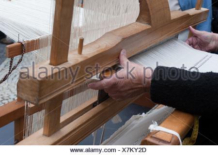 Woman weaving, Loom, Bratislava, Slovakia - Stock Photo