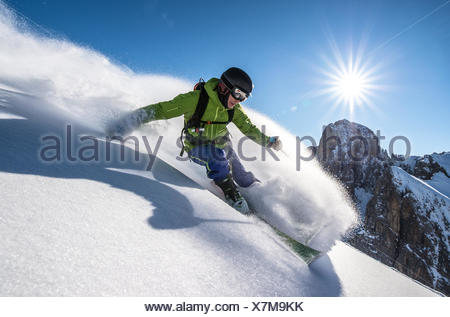 Man skiing off piste, Dolomites, Italy - Stock Photo