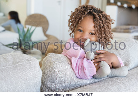 Portrait of a smiling girl holding a teddy bear - Stock Photo